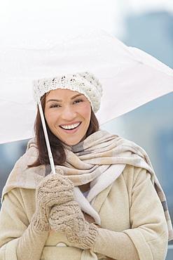 Portrait of woman with umbrella