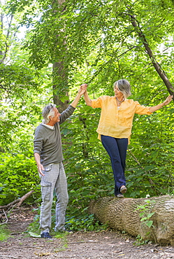 Senior couple hiking in forest, Central Park, New York City