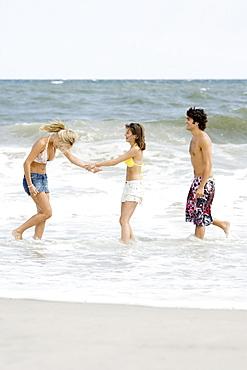 Friends standing in ocean surf