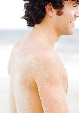 Man with sand on back