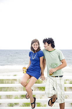 Couple drinking beer at beach