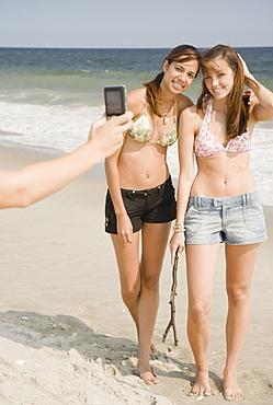 Young women having photograph taken