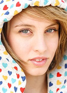 Close up of woman wearing hood