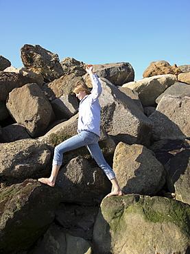 Woman climbing on rocks