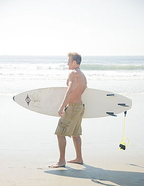 Man holding surfboard