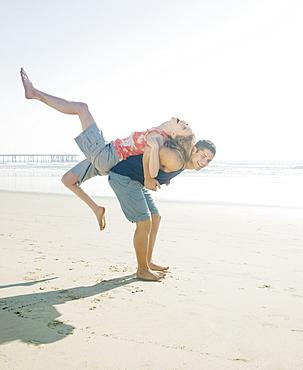 Couple playing around on beach