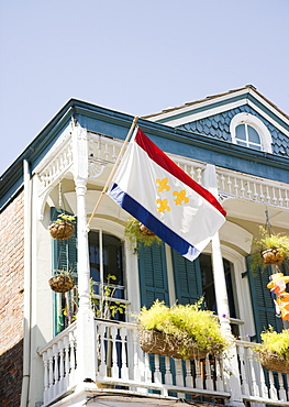 Low angle view of flag on balcony, French Quarter, New Orleans, Louisiana, United States