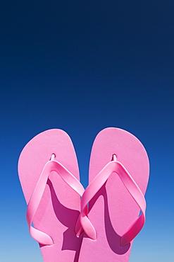 Oregon, Florence, Pink flip-flops against blue sky