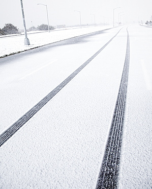 USA, New York State, Rockaway Beach, tire track in snow on road