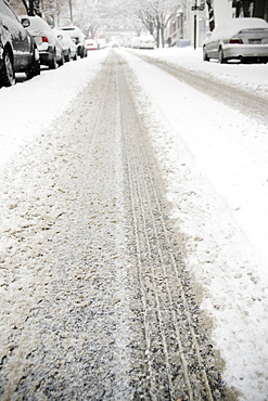 USA, New York State, Brooklyn, Williamsburg, tire track on snow covered street