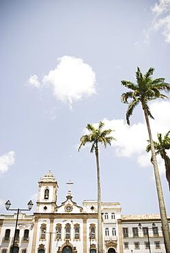 Brazil, Bahia, Salvador De Bahia, Facade of old church with palm trees in front