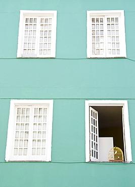 Brazil, Bahia, Salvador De Bahia, Facade of building with birdcage on open window