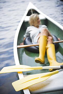 Roaring Brook Lake, Woman sitting in boat