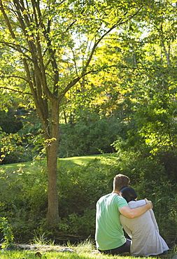 Couple sitting in park, Newtown, Connecticut