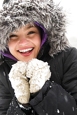 Portrait of smiling woman in warm clothing at winter