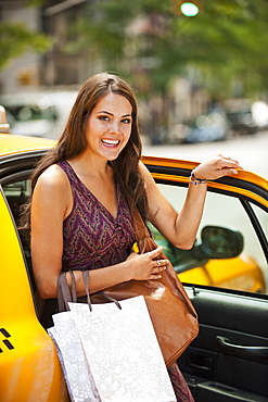 Woman exiting taxi