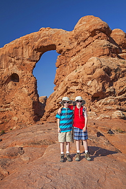Twin Boys (10-11) Hiking, USA, Utah, Arches National Park, Moab