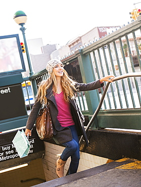 Portrait of blond woman leaving subway station, USA, New York City, Brooklyn, Williamsburg