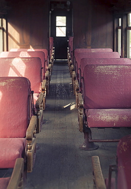 Aisle in old fashioned train passenger cart