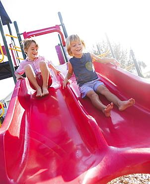 Boys (4-5, 8-9) playing on playground, Jupiter, Florida, USA