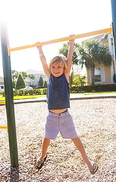 Boy (4-5) playing on playground, Jupiter, Florida, USA