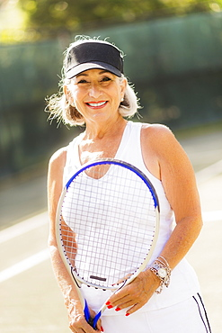 Portrait of senior woman on tennis court
