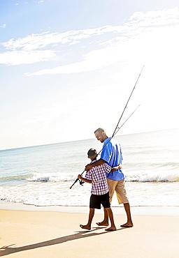 Father and son (10-11) fishing, Jupiter, Florida