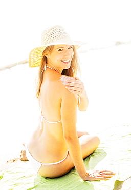 Woman applying sun protector