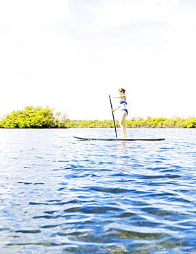 Woman on paddle board, Jupiter, Florida