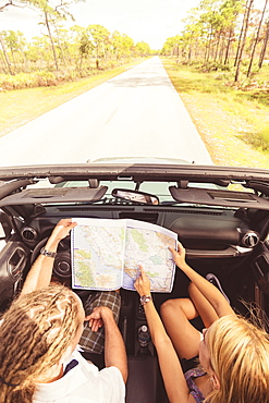 Couple checking map while driving, Tequesta, Florida