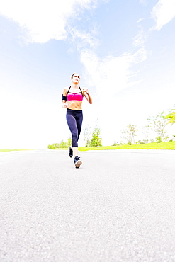 Young woman jogging in park, Jupiter, Florida