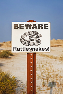 Beware snakes - warning sign, USA, South Dakota, Badlands National Park