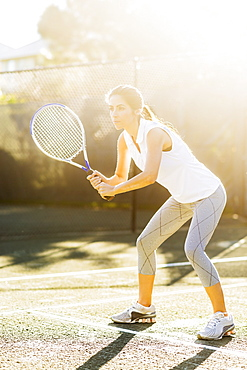 Portrait of young woman playing tennis in outdoor court, Jupiter, Florida
