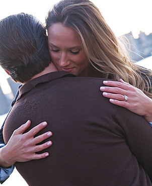 USA, New York, Long Island City, Young couple embracing outdoors