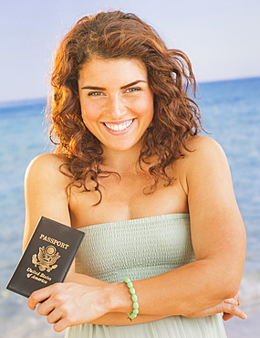 Portrait of smiling woman with passport