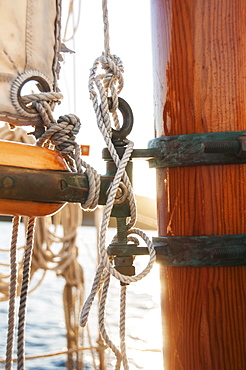Close-up view of yacht ropes, boom and main mast