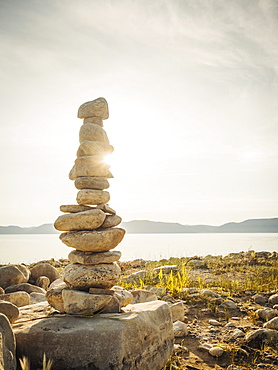 Stack of stones by lake, USA, Utah, Bear Lake