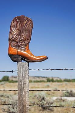 Rozet, Leather cowboy boot on post, Rozet, Wyoming