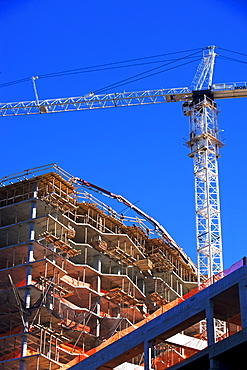 Low angle view of construction site and crane
