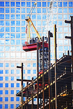 Urban construction site with crane