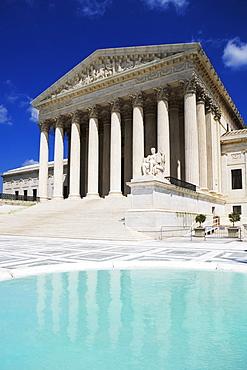Columned building and reflecting pool, Washington DC, United States