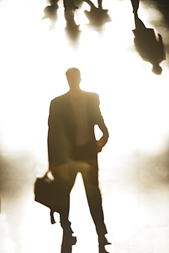 Silhouette of businessman holding briefcase