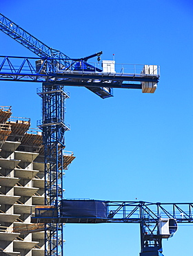 Building under construction and crane