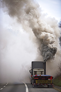 Large semi truck emitting exhaust fumes