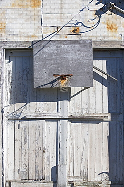 Basketball net on rustic building