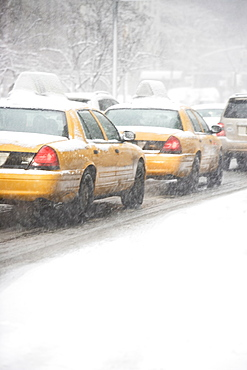 USA, New York City, yellow cabs on snowy street