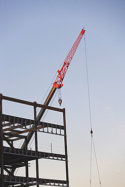 Crane with unfinished built structure