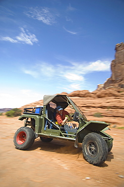 Man driving off-road vehicle in desert