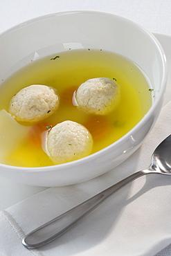Close up of Matzah ball soup