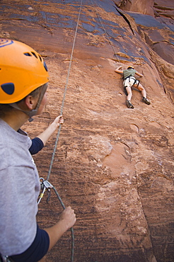 Two people rock climbing